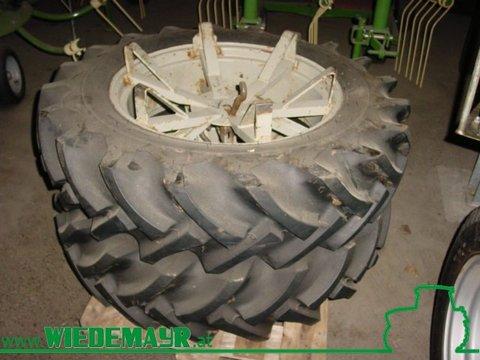 za traktor Firestone 12,4-28/11-28 kostaju 1000 EUR sa PDV-om. Dodatna