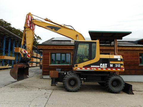 CAT M312 (13,6t) POWERTILT + hydr. SW + Breitreifen!